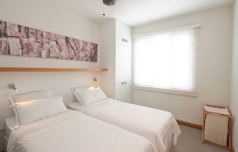 Cape Bay Luxury Beach Apartments By BARNES - Room - 11