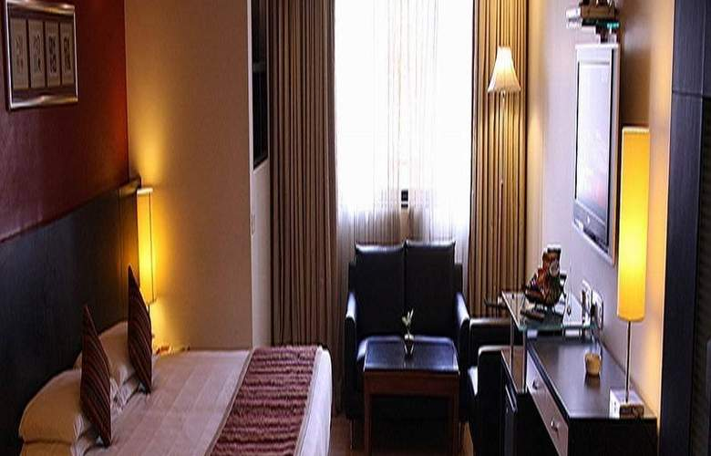 Ramee Guestline Apartments Abudhabi - Room - 4