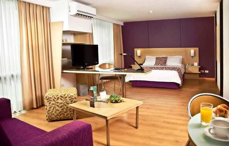 Novelty Suites - Room - 1