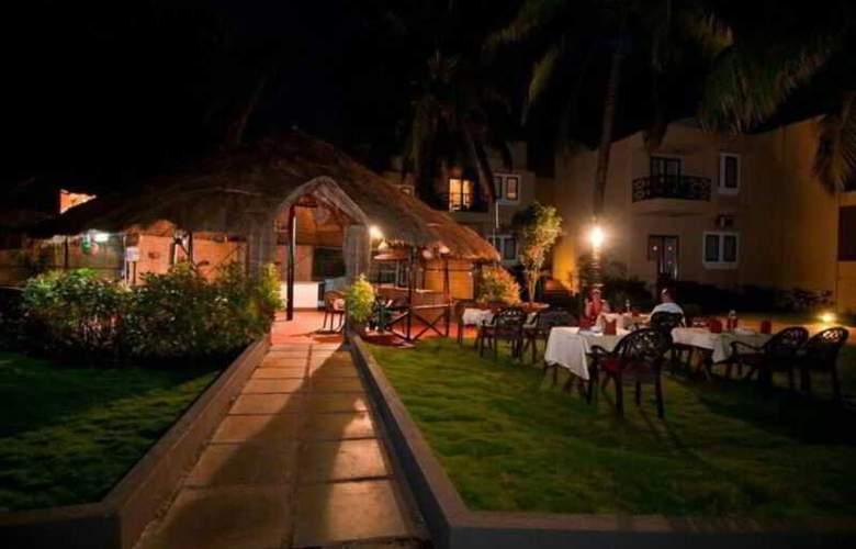 Whispering Palms Beach Resort - Restaurant - 15