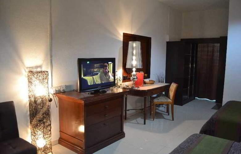 Rasa Eksotika Vacation Home - Room - 18