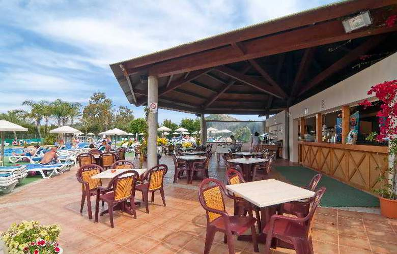 Eix Lagotel Hotel y apartamentos - Restaurant - 26