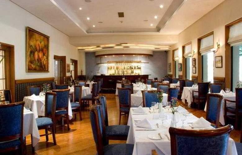 Parque 97 Suites - Restaurant - 4