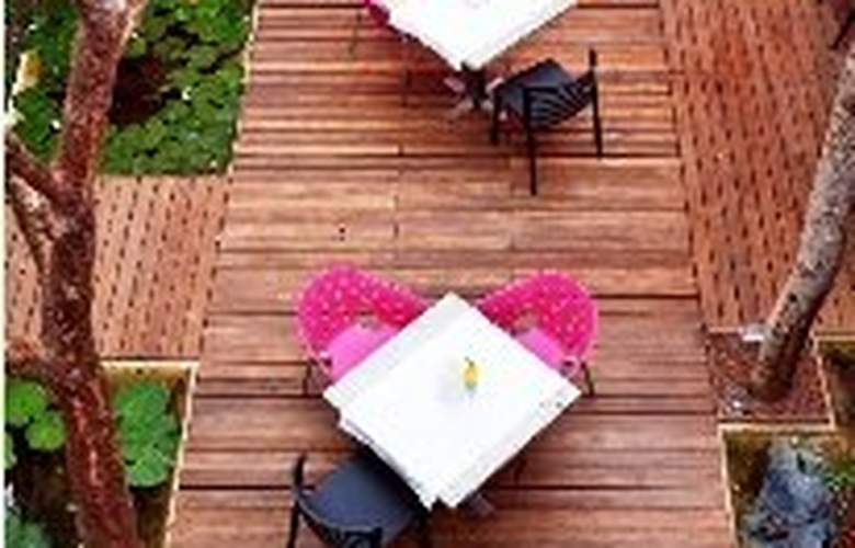 Rosas & Xocolate Boutique Hotel Spa - Terrace - 5