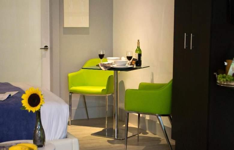 Seaside Apartments - Room - 11