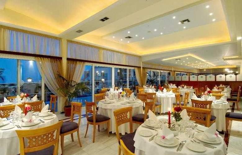 Selini Suites - Restaurant - 8