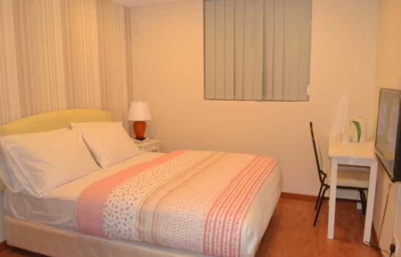 Golden Suites Hotel - Room - 8