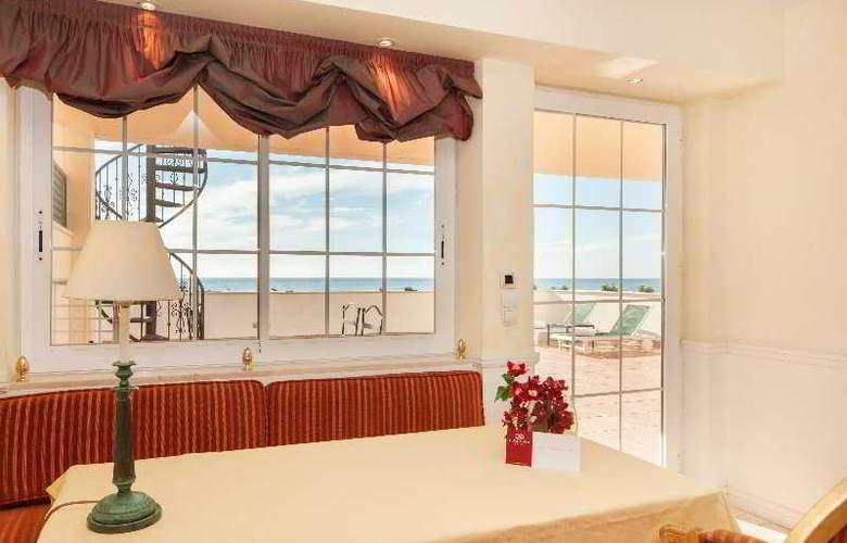 Apartamentos Guadalpin Suites - Room - 7
