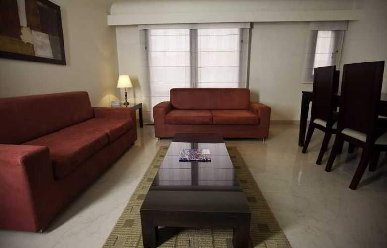 Travelers Apartamentos y Suites CondominioPlenitud - Room - 1