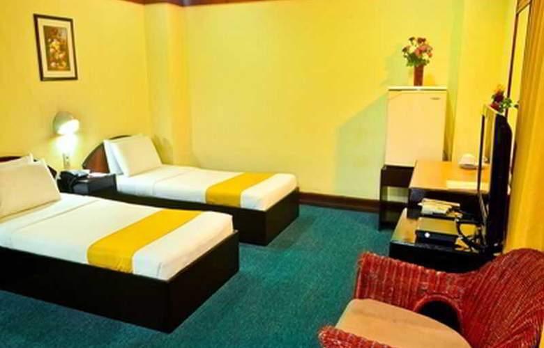Paragon Suites - Room - 9