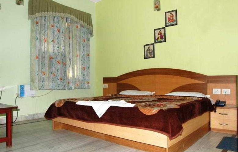 Ambica Deluxe - Room - 5