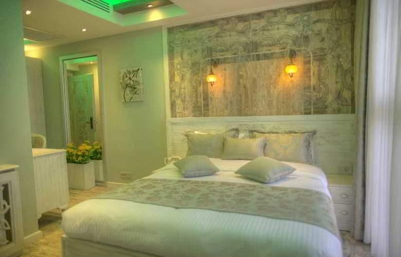 Elegance Asia Hotel - Room - 12