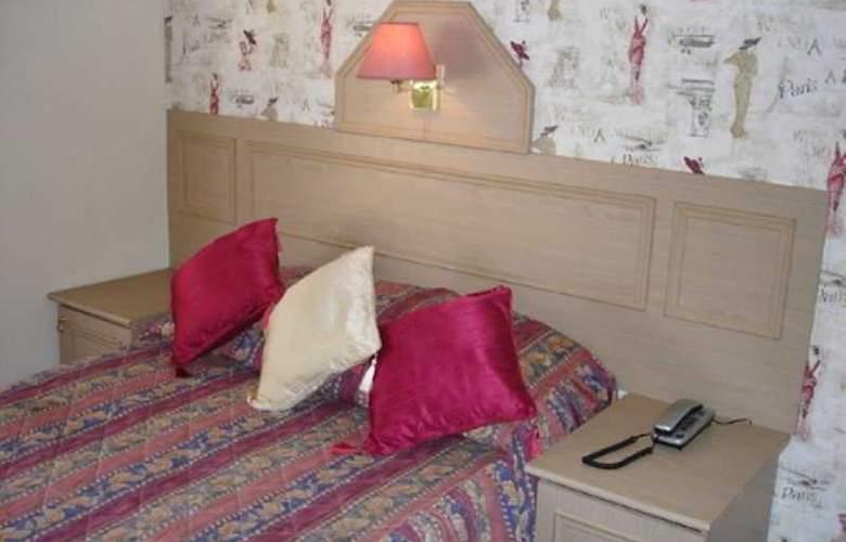 La Parisienne Hotel - Room - 4