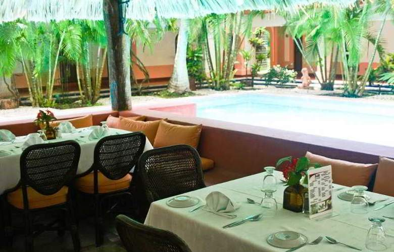 Villas Arqueológicas Chichén Itzá - Restaurant - 32