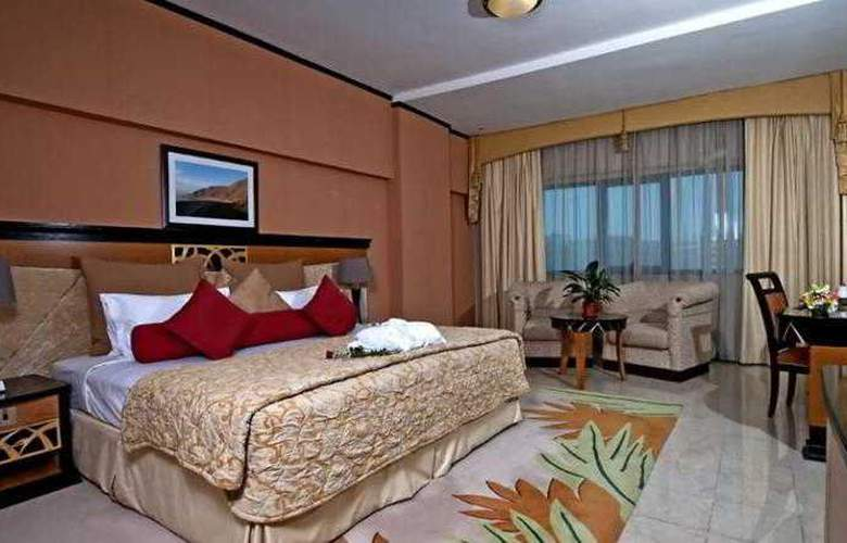 Al Jawhara Gardens - Room - 10