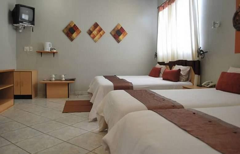 Makalani Hotel - Room - 5