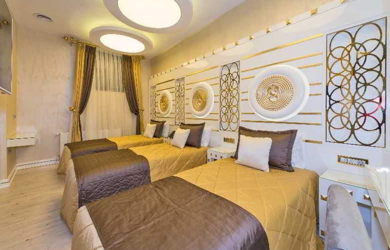 The Million Stone Hotel - Room - 10