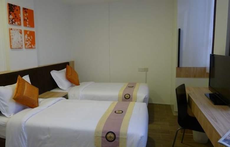 Soluxe Inn - Room - 8