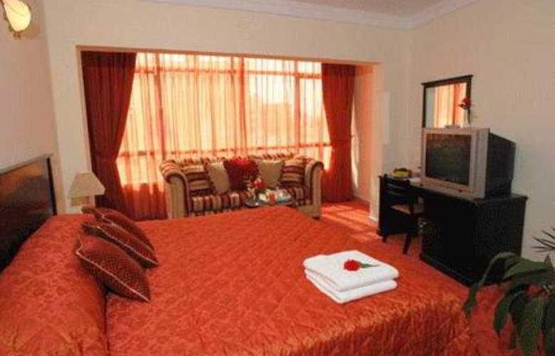 Al Jawhara Metro Hotel - Room - 4
