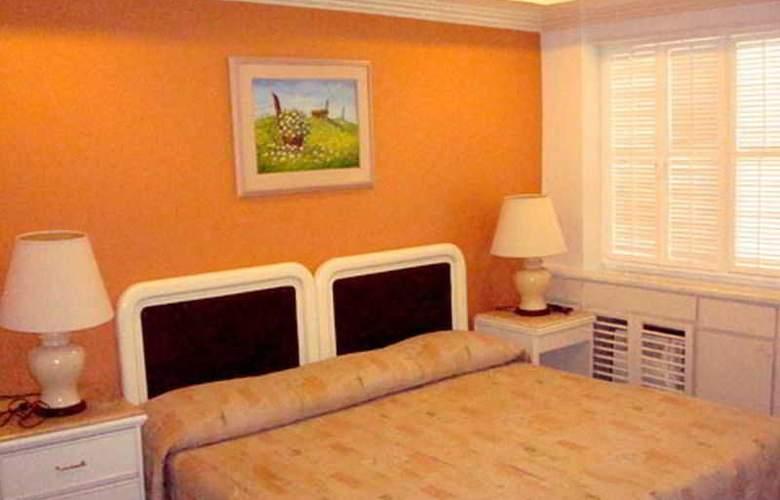 Lourdes Suites - Room - 4