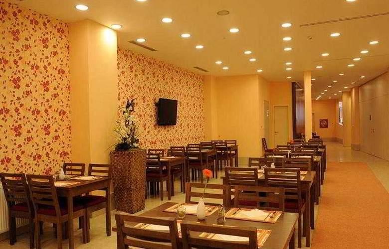 Iris Hotel Eden - Restaurant - 3