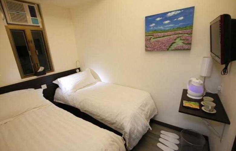 Homy Inn - Room - 9