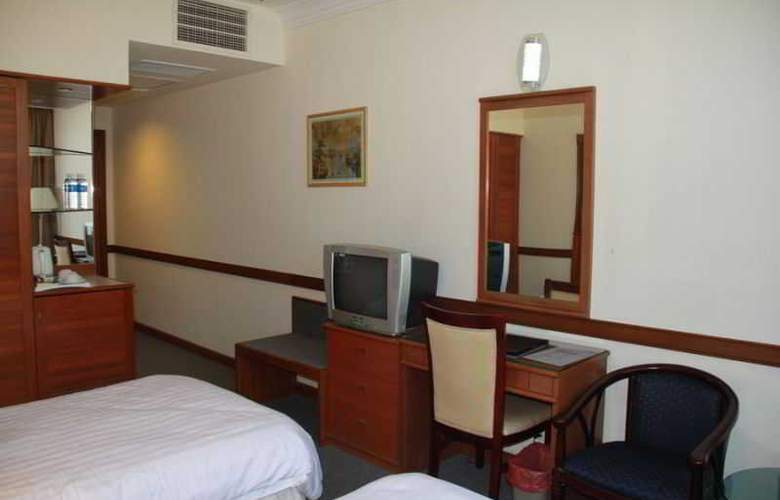 Grand City Hotel - Room - 5