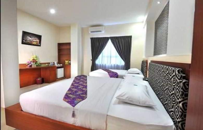 Gaja Hotel Pekanbaru - Room - 7