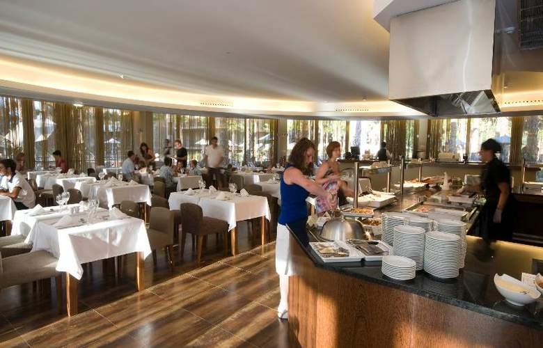 Nau Salgados Palm Village Apartments & Suites - Restaurant - 16