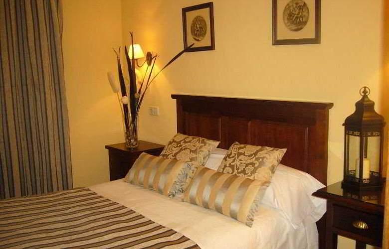 De Los Reyes Apartamentos Turisticos - Room - 1
