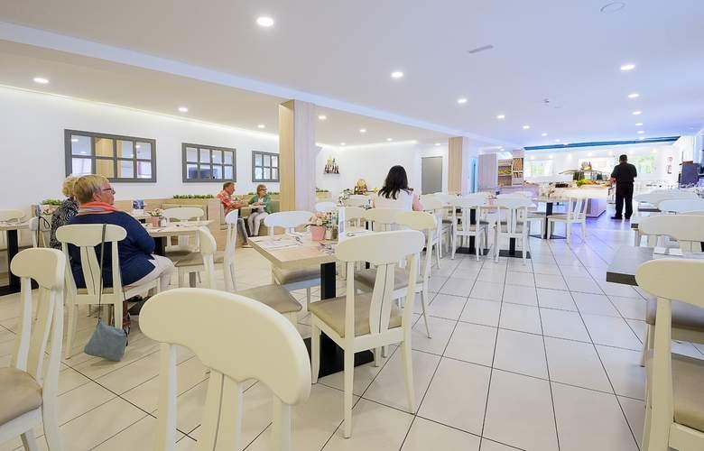 Flor Los Almendros Hotel - Restaurant - 23