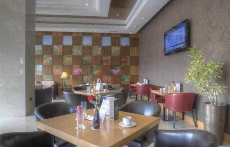 Siji Hotel Apartments - Restaurant - 4