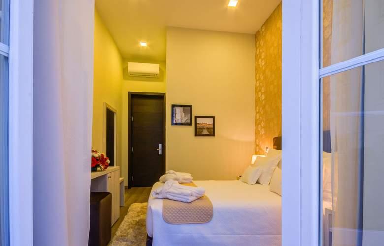 Americano Inn Rosio - Room - 7
