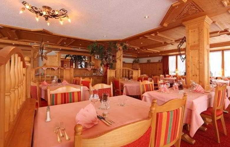 Walliserhof Swiss Quality Hotel - Restaurant - 7