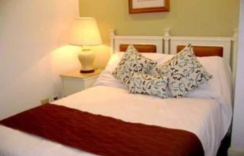 Lourdes Suites - Room - 7