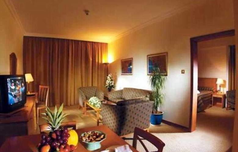 Swiss-Belhotel Sharjah - Room - 5
