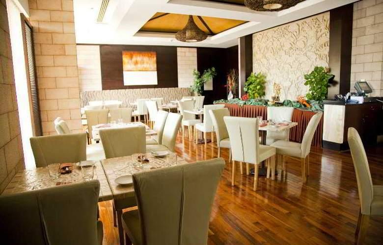 Park Hotel Apartment - Restaurant - 11