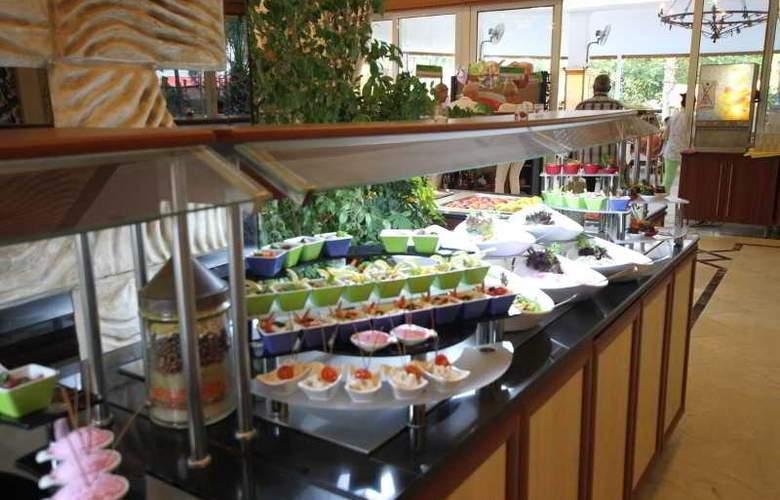 L´ Etoile Beach Hotel - Restaurant - 4