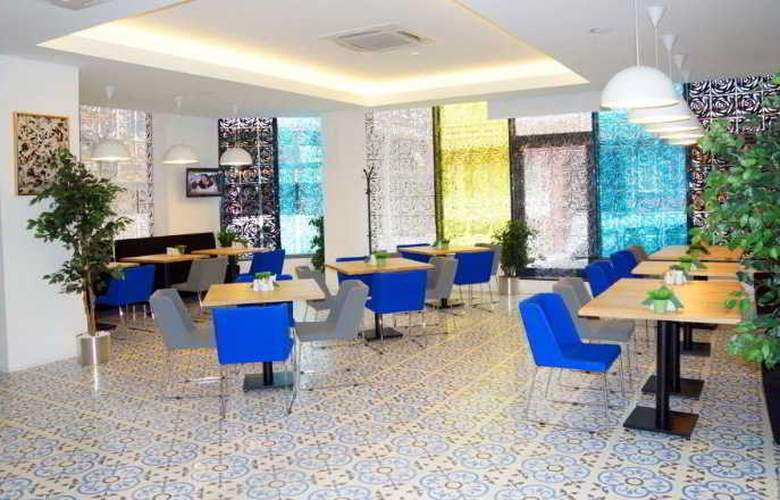 Tempo Suites Airport - Restaurant - 15