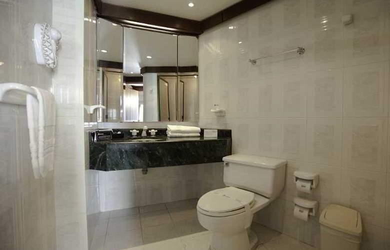 Travelers Apartamentos y Suites CondominioPlenitud - Room - 7