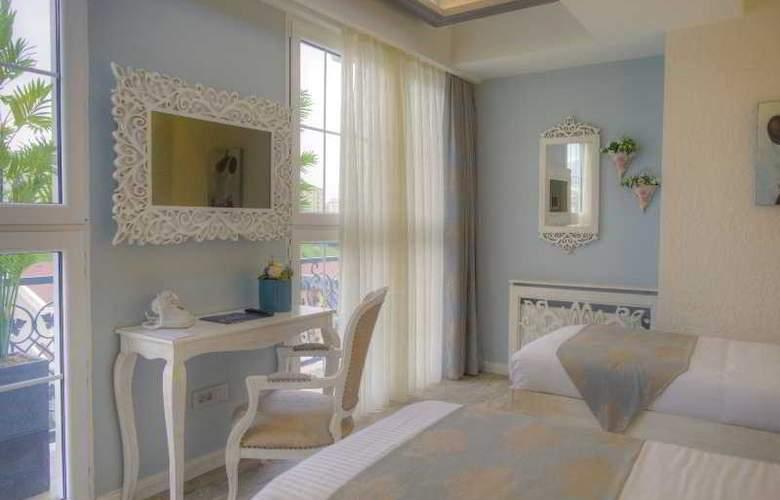 Elegance Asia Hotel - Room - 18