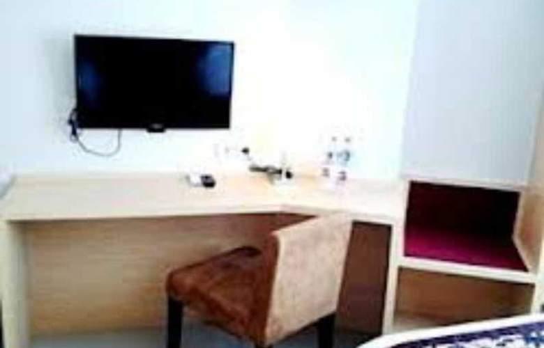 Bekizaar Business Hotel - Room - 9
