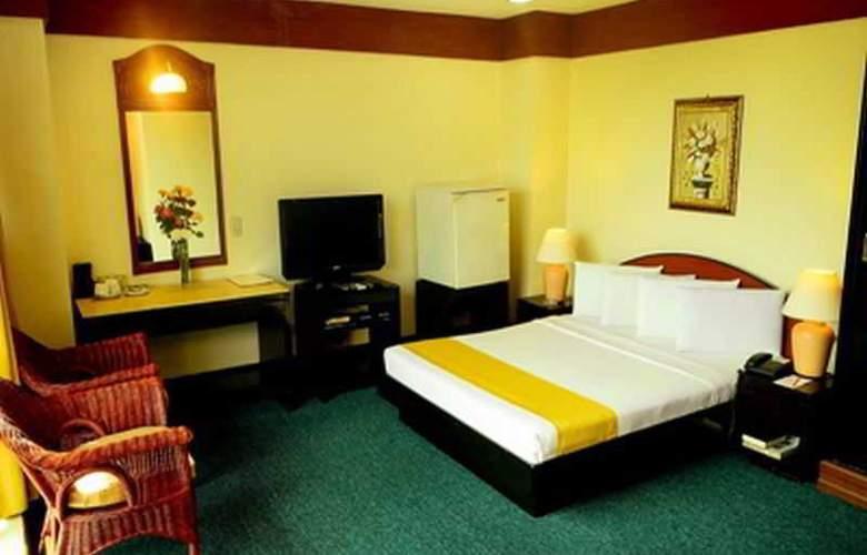 Paragon Suites - Room - 6