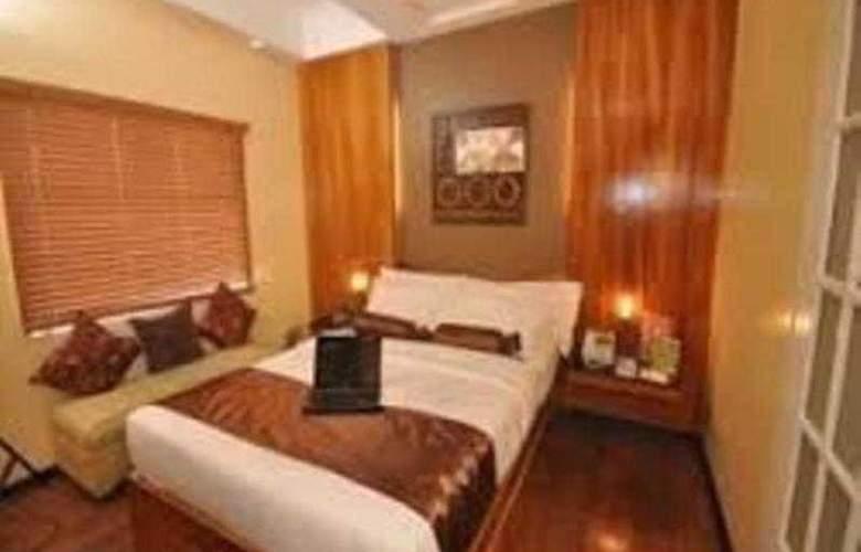 Tri-Place Hotel Quezon - Room - 12