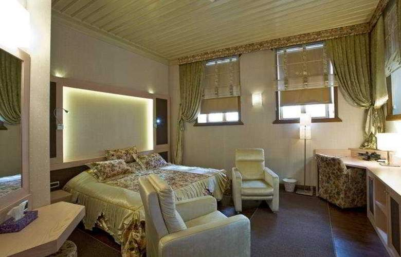 Puding Suite Hotel - Room - 5