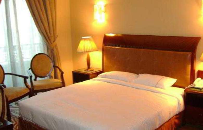 Tulip Inn Hotel Apartments Sharjah - Room - 9