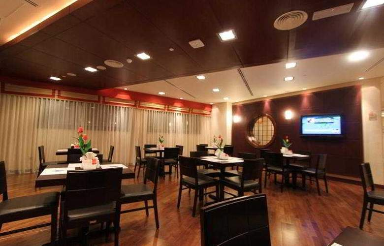 Tulip Hotel Apartment - Restaurant - 6