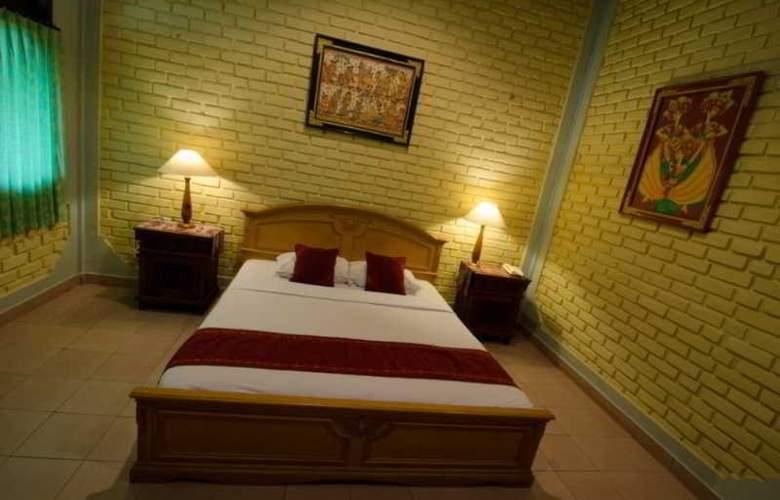 Kuta Puri Bungalow - Room - 12