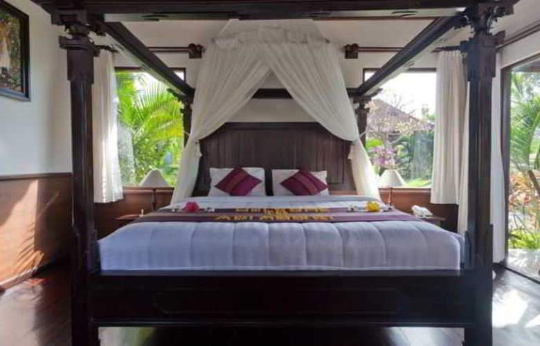 Adi Assri Beach Cottages Singaraja - Room - 13
