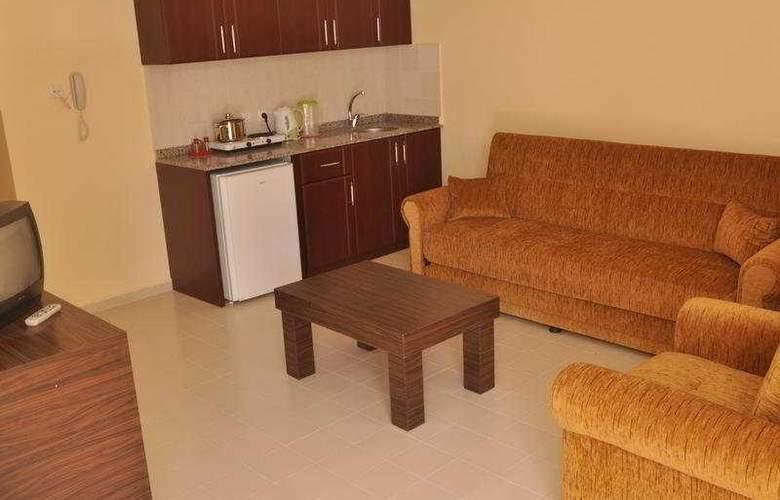 Primera Hotel Apart - Room - 4